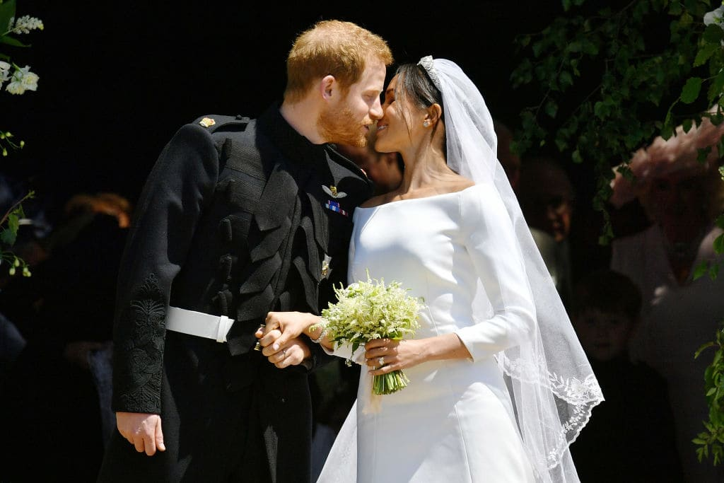 Prince Harry and Meghan Markle kiss on the steps of St George's Chapel in Windsor Castle after their wedding in St George's Chapel at Windsor Castle on May 19, 2018 in Windsor, England. (Photo by Ben Birchall - WPA Pool/Getty Images)