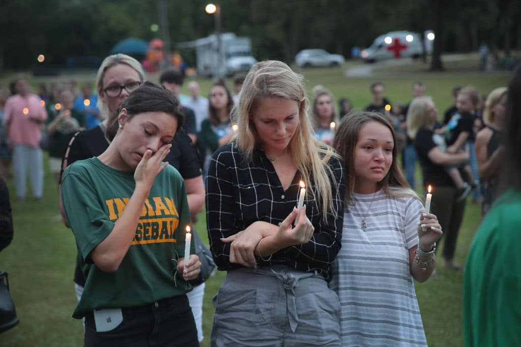 Residents attend a prayer vigil to remember the victims from the Santa Fe High School shooting at Walter Hall Park on May 20, 2018, in League City, Texas. (Photo by Scott Olson/Getty Images)