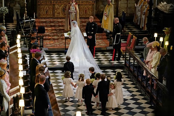 The flower girls and page boys follow the royal couple with Prince George bringing up the rear(Source: Getty Images)
