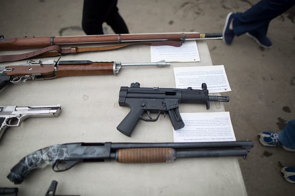 At least 1,300 children die every year from incidents involving guns. (Photo by David McNew/Getty Images)