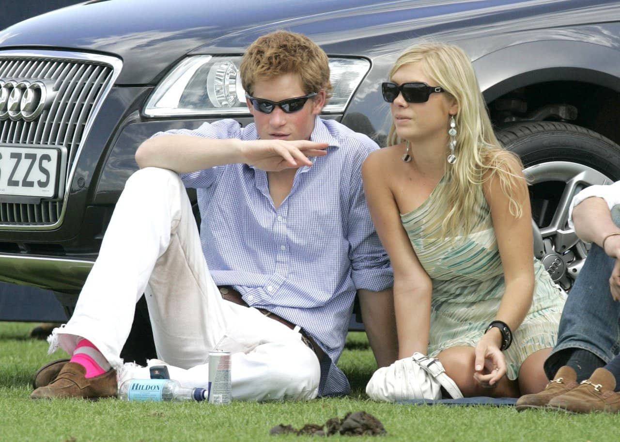 Prince Harry and his girlfriend Chelsy Davy attend the Cartier International Polo match at the Guards Polo Club on 30 July, 2006 in Egham, England. (Photo by MJ Kim/Getty Images)