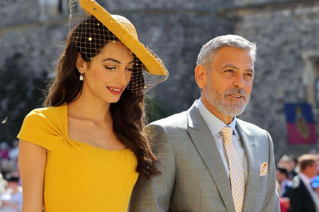 AmalClooney and George Clooney arrive at St George's Chapel at Windsor Castle before the wedding of Prince Harry to MeghanMarkle on May 19, 2018 in Windsor, England (Photo by Gareth Fuller - WPA Pool/Getty Images)