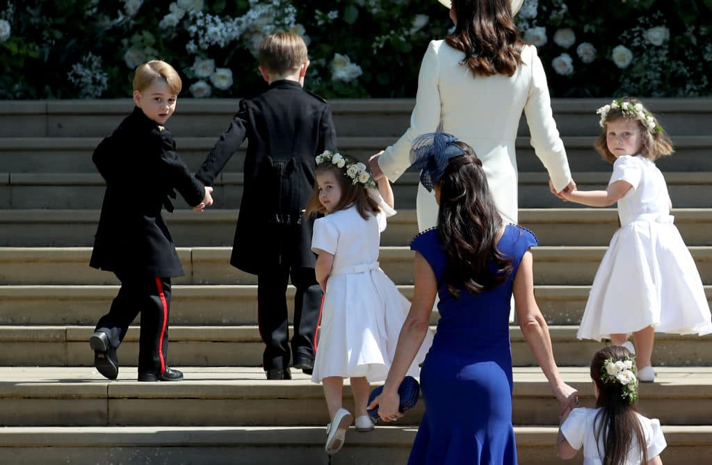 Prince George of Cambridge, Jasper Dyer, Princess Charlotte of Cambridge, Catherine, Duchess of Cambridge, Jessica Mulroney, Ivy Mulroney and Florence van Cutsem arrive at the wedding of Prince Harry and Ms Meghan Markle at St George's Chapel at Windsor Castle on May 19, 2018 in Windsor, England (Photo by Jane Barlow - WPA Pool/Getty Images)