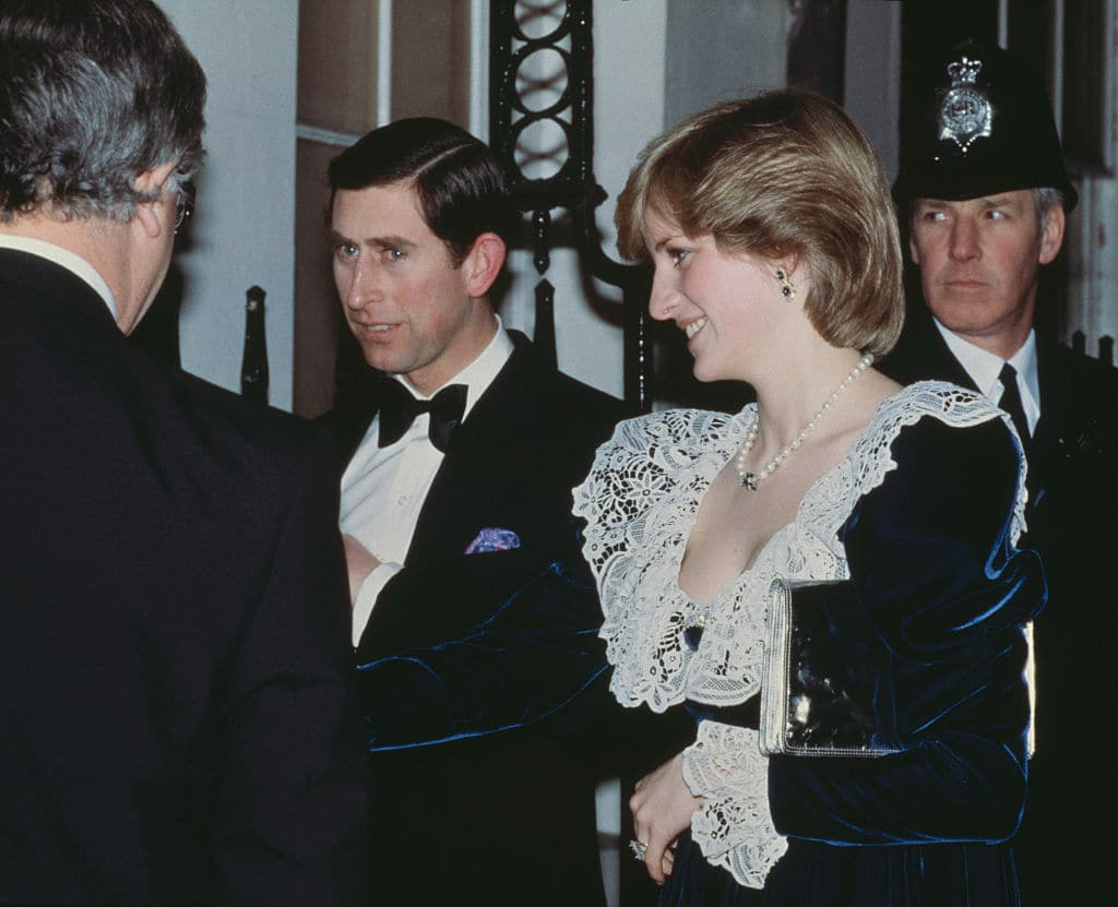 Diana wears a lace and velvet gown by Bellville Sassoon (Photo by Central Press/Hulton Archive/Getty Images)