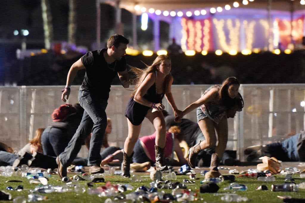 People run from the Route 91 Harvest country music festival after apparent gun fire was heard on October 1, 2017 in Las Vegas, Nevada (Getty Images)