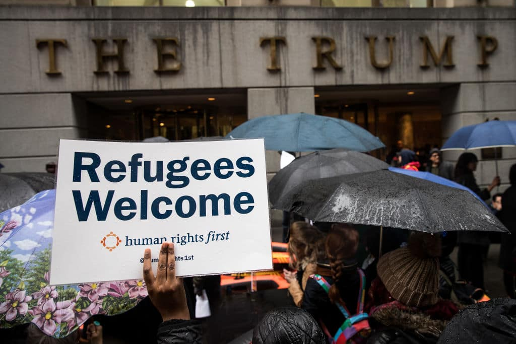 rotestors rally in front of the Trump Building on Wall Street during a protest against the Trump administration's proposed travel ban and refugee policies, March 28, 2017 in New York City. (Getty Images)
