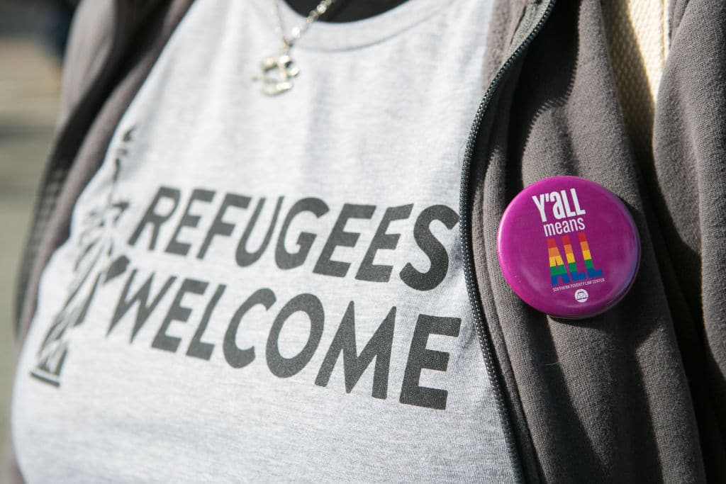 'Y'all Means All' button on a protestors shirt during an Interfaith Rally for Muslims and Refugees at the Lutheran Church of the Redeemer on February 4, 2017 in Atlanta, Georgia. (Getty Images)