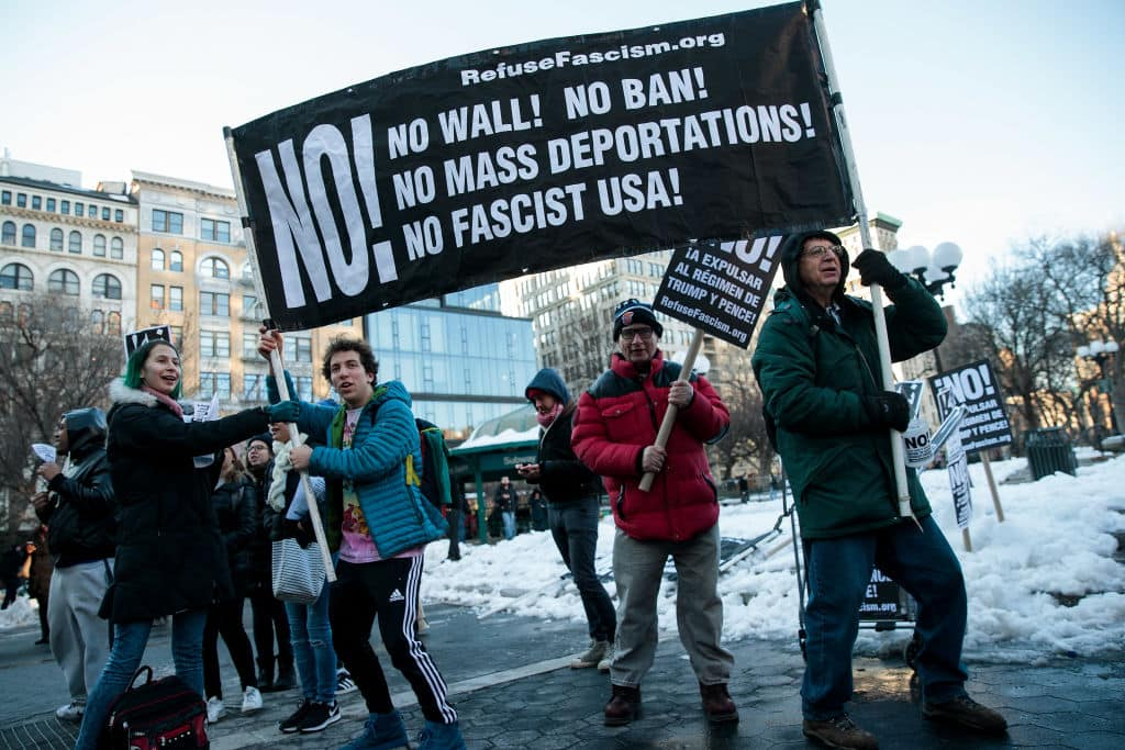 Demonstrators hold up a banner during a protest of President Donald Trump's proposed travel ban and suspension of the country's refugee program, March 16, 2017 in New York City. (Getty Images)