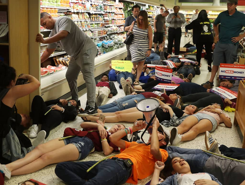 The student protestors at Publix all lay on the ground for 12 minutes (Getty Images)