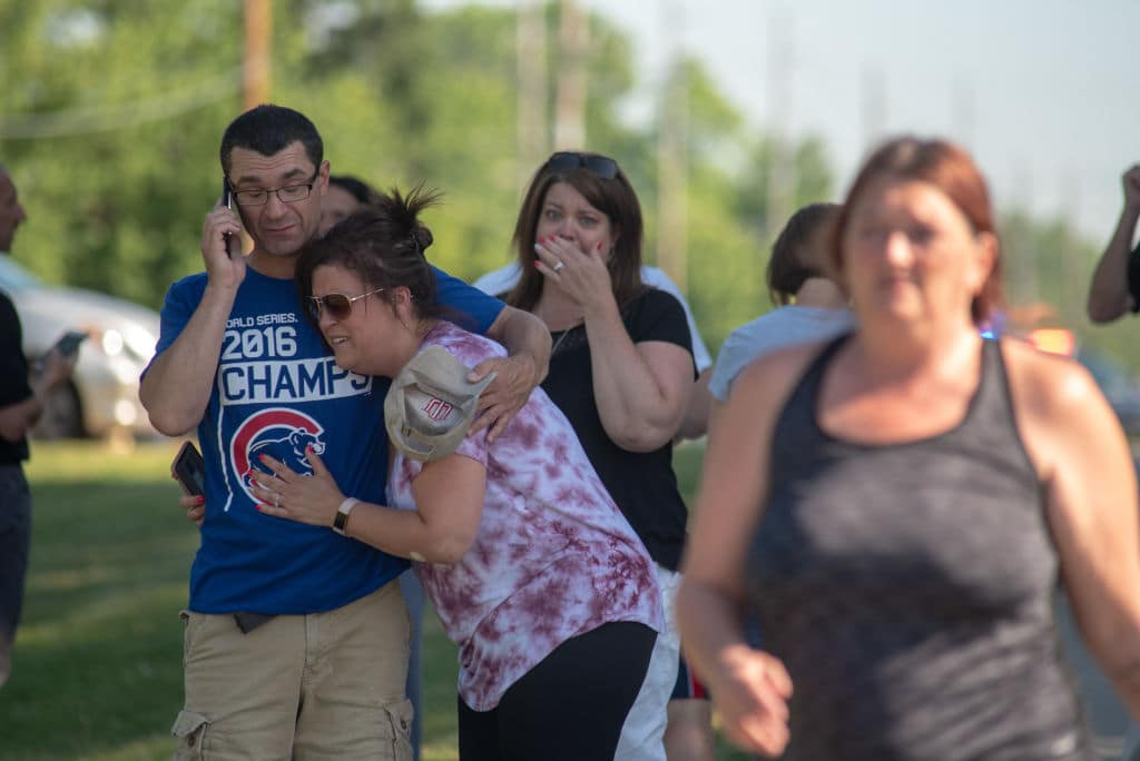 Parents comfort each other as they wait outside Noblesville West Middle School after a shooting at the school on May 25, 2018 in Noblesville, Indiana. One teacher and one student were initially reported injured. (Getty Images)