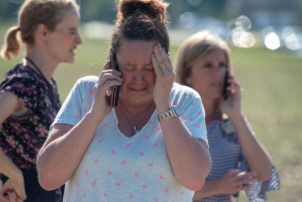 Instructional Assistant Paige Rose reacts outside Noblesville West Middle School after a shooting at the school on May 25, 2018 in Noblesville, Indiana. (Getty Images)