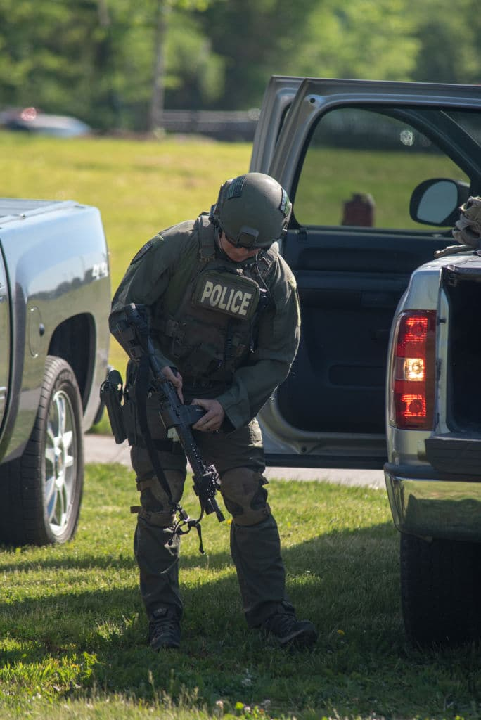 A SWAT officer loads his weapon outside Noblesville West Middle School after a shooting at the school on May 25, 2018 in Noblesville, Indiana. (Getty Images)