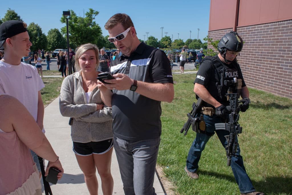 Parents wait while a SWAT officer passes outside Noblesville High School after a shooting at Noblesville West Middle School on May 25, 2018 in Noblesville, Indiana. (Getty Images)