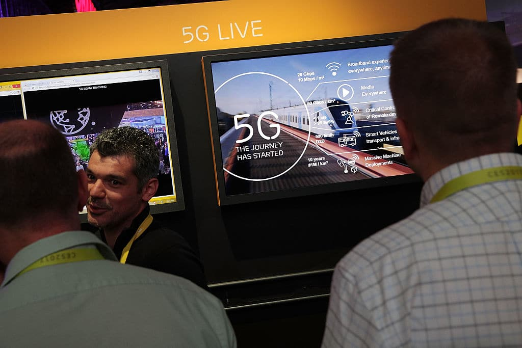 Attendees listen to information about 5G, aka 5th generation mobile networks, at the Ericsson booth during CES 2017 at the Las Vegas Convention Center on January 5, 2017, in Las Vegas, Nevada. (Photo by Alex Wong/Getty Images)