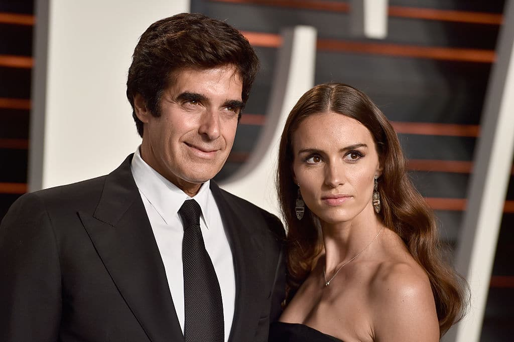 Magician David Copperfield (L) and model Chloe Gosselin attend the 2016 Vanity Fair Oscar Party Hosted By Graydon Carter at the Wallis Annenberg Center for the Performing Arts on February 28, 2016 in Beverly Hills, California. (Photo by Pascal Le Segretain/Getty Images)