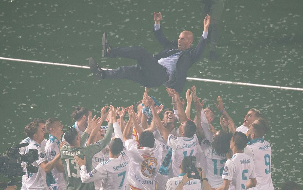 Zinedine Zidane, Manager of Real Madrid is thrown in the air by his players during celebrations at the Santiago Bernabeu stadium following their victory last night in Kiev in the UEFA Champions League final, on May 27, 2018, in Madrid, Spain. Real beat Liverpool 3-1 in the final to lift the European Cup and Champions League for the 13th time. (Photo by Denis Doyle/Getty Images)