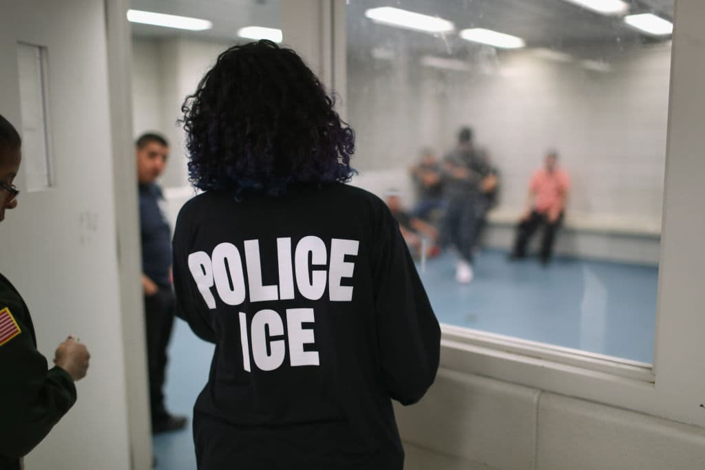 Undocumented immigrants wait in a holding cell at a US Immigration and Customs Enforcement (ICE) processing center in New York City on April 11 (Getty Images)