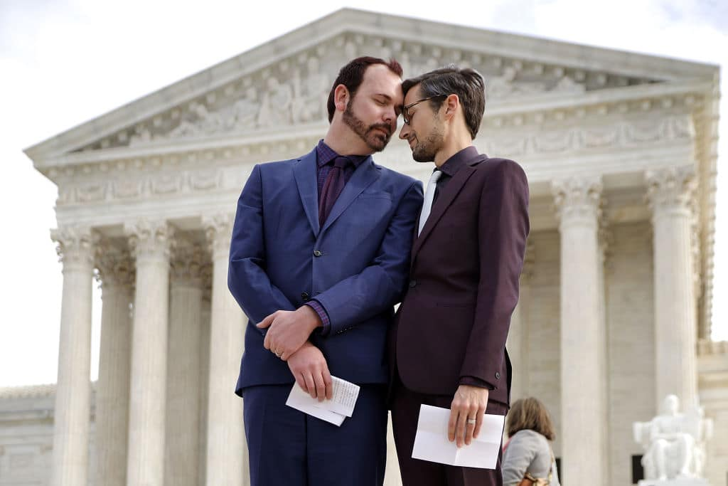 David Mullins (L) and Charlie Craig wait to speak to journalists after the U.S. Supreme Court hear the case Masterpiece Cakeshop v. Colorado Civil Rights Commission December 5, 2017 in Washington, DC. (Getty Images)