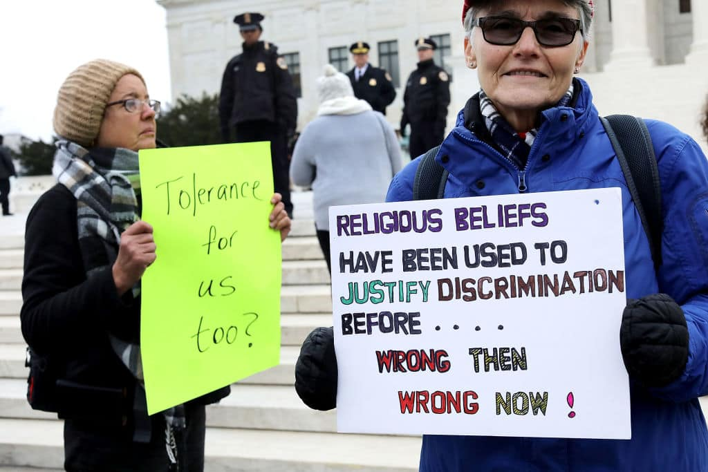 Protesters on both sides of the issue rally in front of the Supreme Court building on the day the court is to hear the case Masterpiece Cakeshop v. Colorado Civil Rights Commission December 5, 2017 in Washington, DC. (Getty Images)