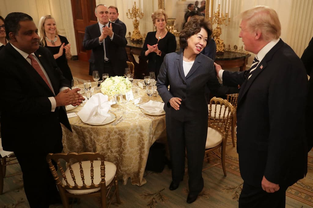 U.S. President Donald Trump (R) greets Secretary of Transportation Elaine Chao and other guests while hosting an Iftar dinner in the State Dining Room at the White House June 6, 2018, in Washington, DC. (Photo by Chip Somodevilla/Getty Images)