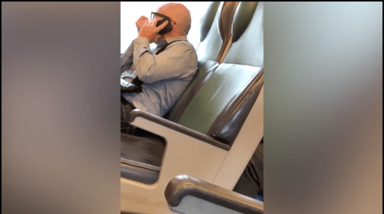 The man captured talking over the phone with someone who seemed to be a call center employee. (Twitter)