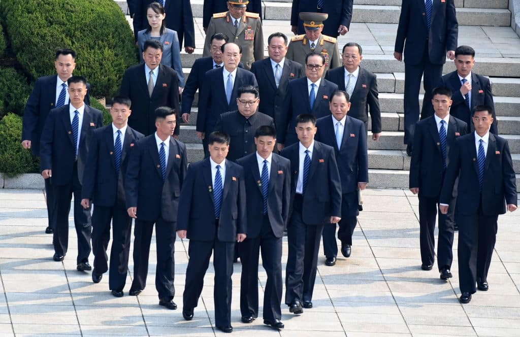 North Korea's leader Kim Jong-un is escorted by his bodyguards as he walks from the North to the Military Demarcation Line that divides the two Koreas to meet with his South Korean counterpart at the truce village of Panmunjom on April 27, 2018. (Getty Images)