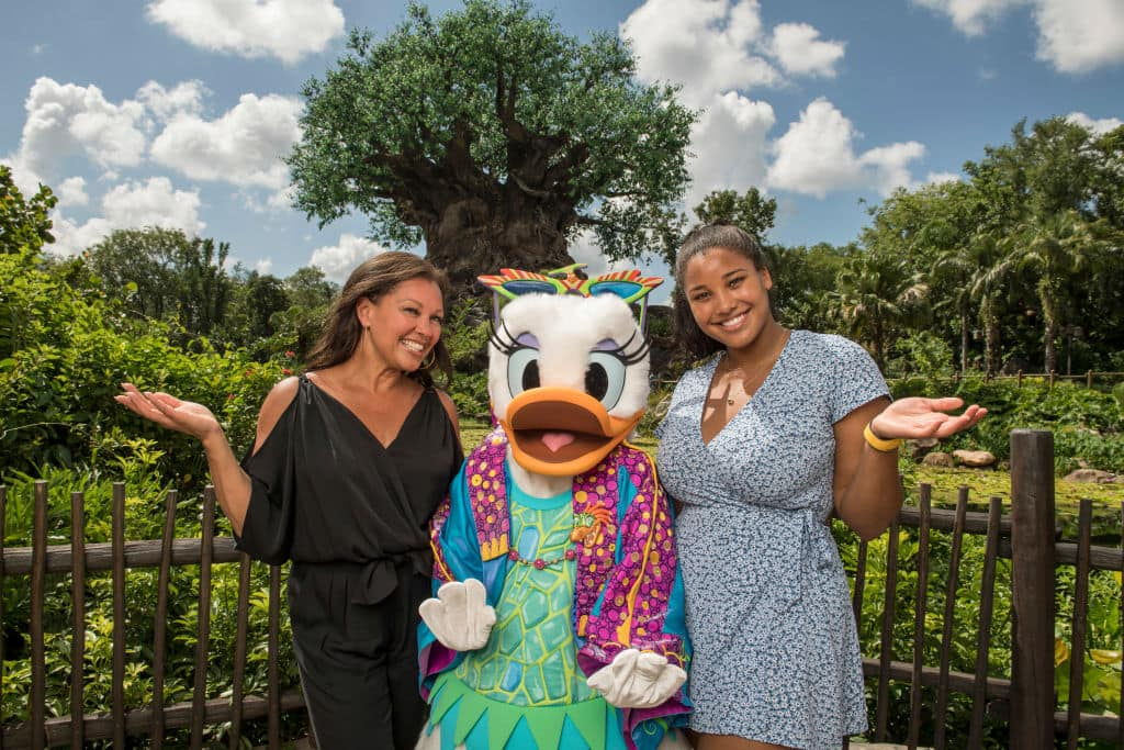 In this handout images provided by Walt Disney World Resort, Actress, singer and fashion designer Vanessa Williams poses with Daisy Duck, donning her fashionable Donald's Dino-Bash! outfit, at Disney's Animal Kingdom on June 12, 2018 in Lake Buena Vista, Florida. (Kent Phillips/Walt Disney World Resort via Getty Images)