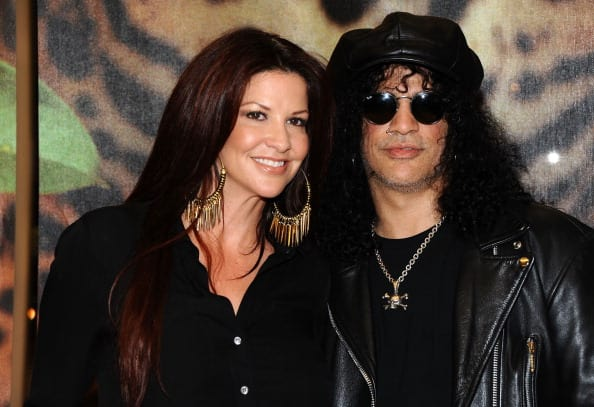 Guitarist Slash and Perla Hudson attend the unveiling of the 2012 Gibson Guitartown new round of guitars on The Sunset Strip at Hornburg Jaguar on March 12, 2012 in Los Angeles, California. Source: Angela Weiss/Getty Images