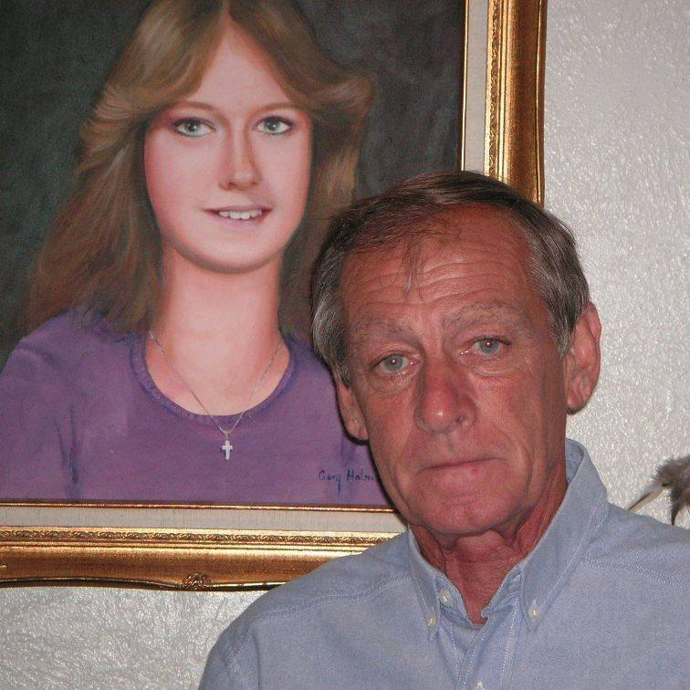 Tim Miller standing in front of a portrait of his daughter, Laura Miller (Facebook)