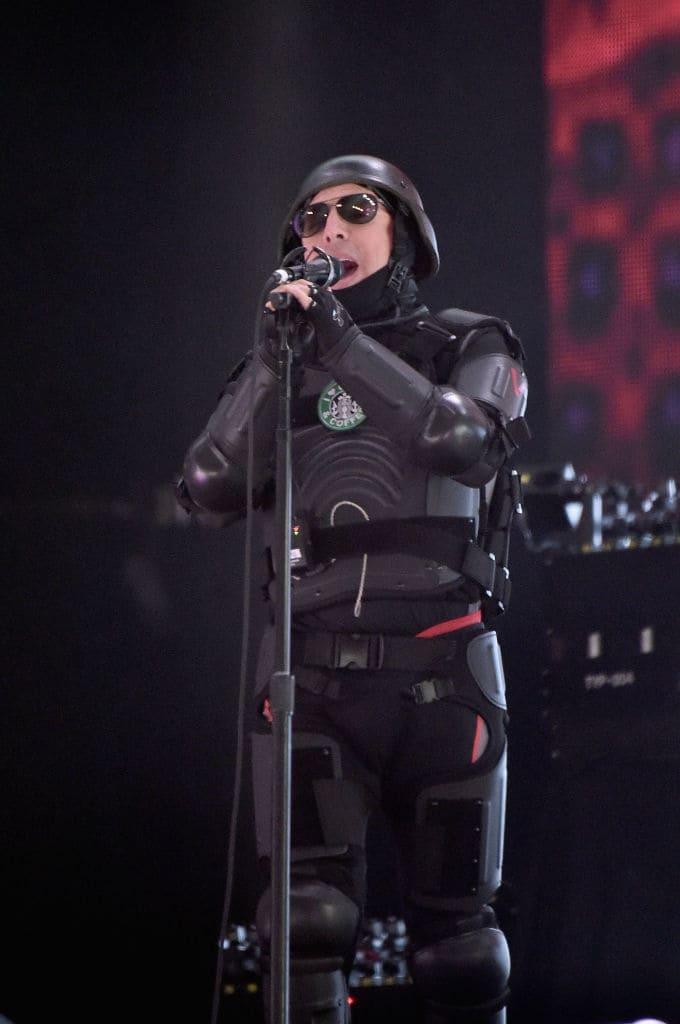 "Maynard in riot gear, complete with a fake Starbucks logo which read ""I ♥ Guns & Coffee"". (Photo by Steven Ferdman/Getty Images)"