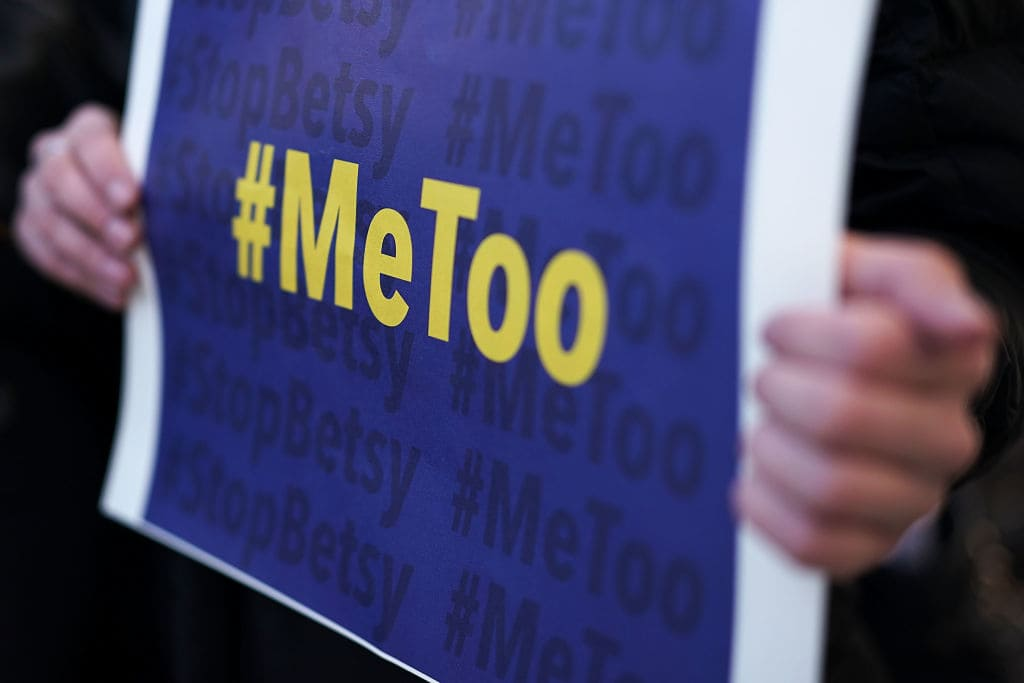An activist holds a #MeToo sign during a news conference on a Title IX lawsuit outside the Department of Education January 25, 2018 in Washington, DC. (Getty Images)