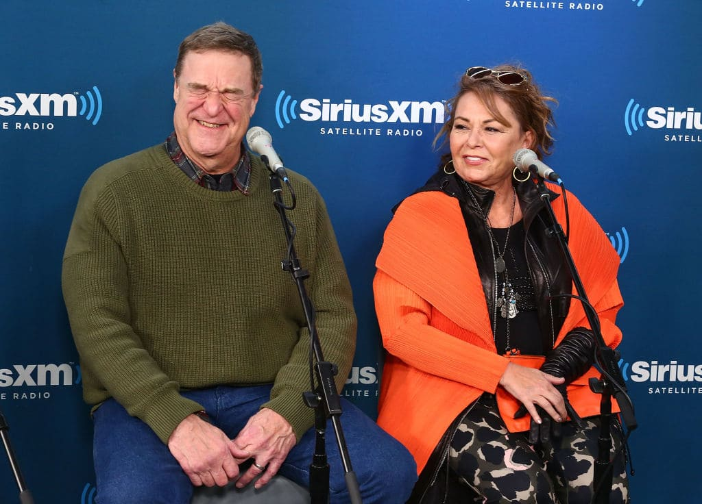 John Goodman and Roseanne Barr speak during SiriusXM's Town Hall with the cast of Roseanne on March 27, 2018 in New York City. Source: Astrid Stawiarz/Getty Images for SiriusXM