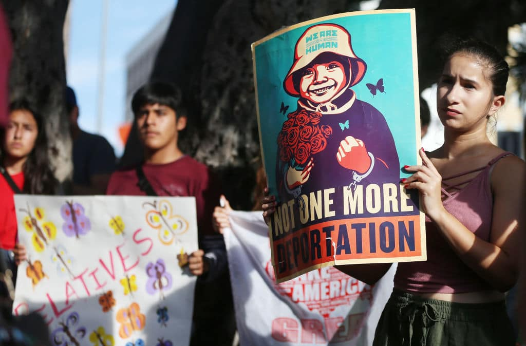 Protestors rally at the 'Families Belong Together March' against the separation of children of immigrants from their families on June 14, 2018 in Los Angeles, California. (Getty Images)