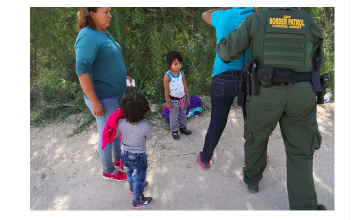 Border Patrol agents take Central American asylum seekers into custody on June 12, 2018 near McAllen, Texas (Getty Images)