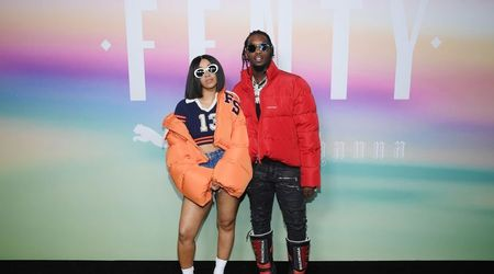 Cardi B reveals her growing baby bump as she strikes a pose with Offset for the cover of a magazine