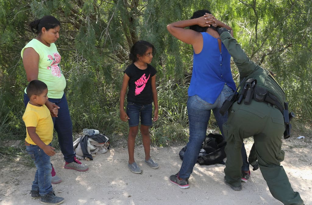 Central American asylum seekers are taken into custody by U.S. Border Patrol agents on June 12, 2018, near McAllen, Texas. (Photo by John Moore/Getty Images)