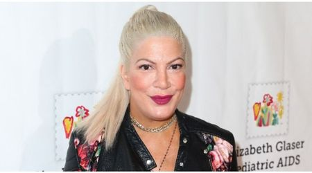 Tori Spelling takes down swimsuit photo after being slammed for photoshopping it to proclaim body positivity