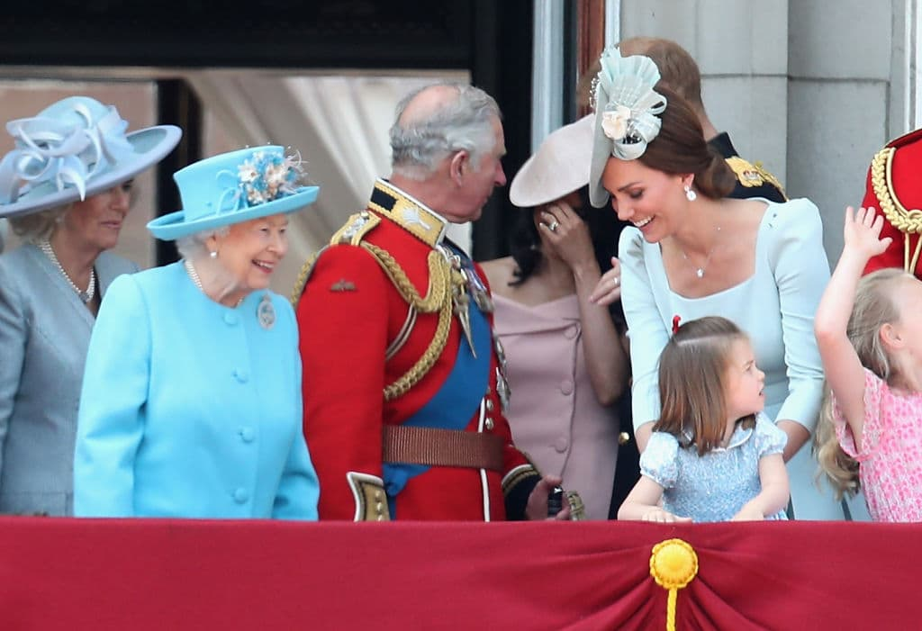 Queen Elizabeth II, Meghan, Duchess of Sussex, Prince Charles, Prince of Wales, Prince Harry, Duke of Sussex, Catherine, Duchess of Cambridge, Prince William, Duke of Cambridge, Princess Charlotte of Cambridge, Savannah Phillips watch the flypast on the balcony of Buckingham Palace during Trooping The Colour on June 9, 2018 in London (Photo by Chris Jackson/Getty Images)