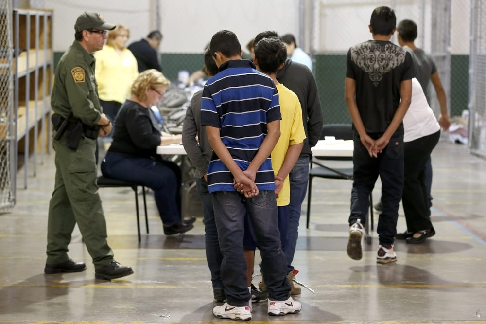 Immigrant children being processed and held at the US Customs and Border Protection Nogales Placement Center on June 18, 2014, in Nogales, Arizon (Photo by Ross D. Franklin-Pool/Getty Images)