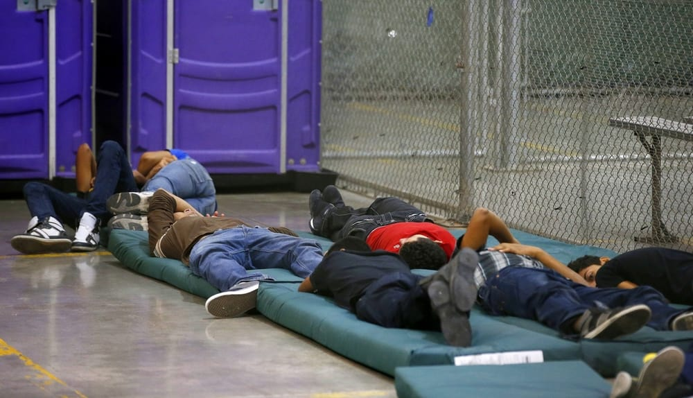 Young boys sleep in a holding cell at the US Customs and Border Protection Nogales Placement Center on June 18, 2014, in Nogales, Arizona. (Photo by Ross D. Franklin-Pool/Getty Images)