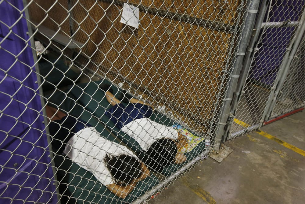 Two female detainees sleep in a holding cell, as the children are separated by age group and gender, as hundreds of mostly Central American immigrant children are being processed and held at the U.S. Customs and Border Protection Nogales Placement Center on June 18, 2014, in Nogales, Arizona. (Photo by Ross D. Franklin-Pool/Getty Images)