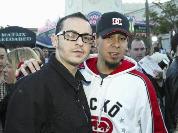 Linkin Park's Mike Shinoda (L) and Chester Bennington arrive at the premiere of 'The Matrix Reloaded' at the Village Theater on May 7, 2003 in Los Angeles, California. (Photo by Kevin Winter/Getty Images)