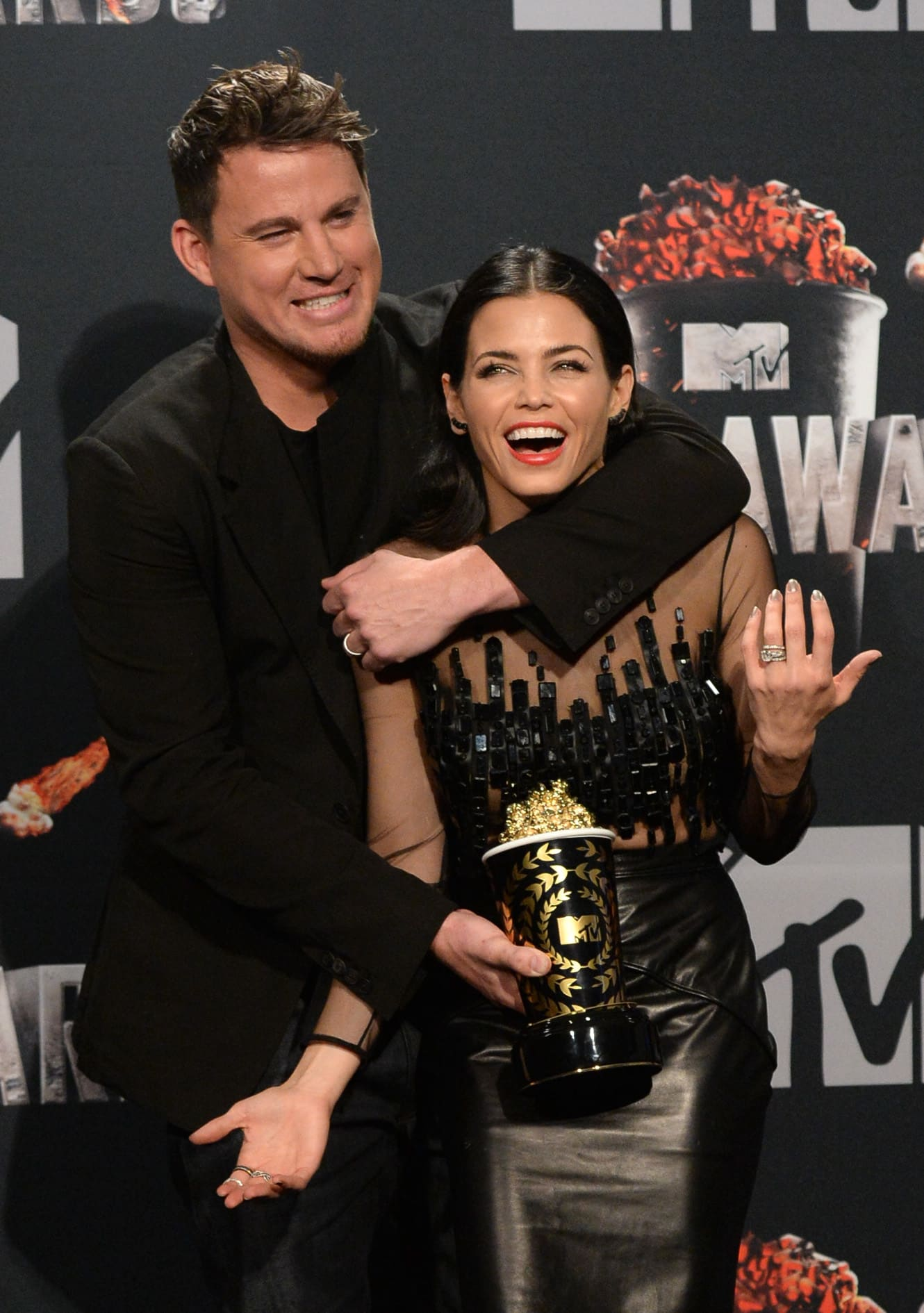 Channing Tatum and Jenna Dewan goofing around at 2014 MTV Movie Awards (Getty Images)