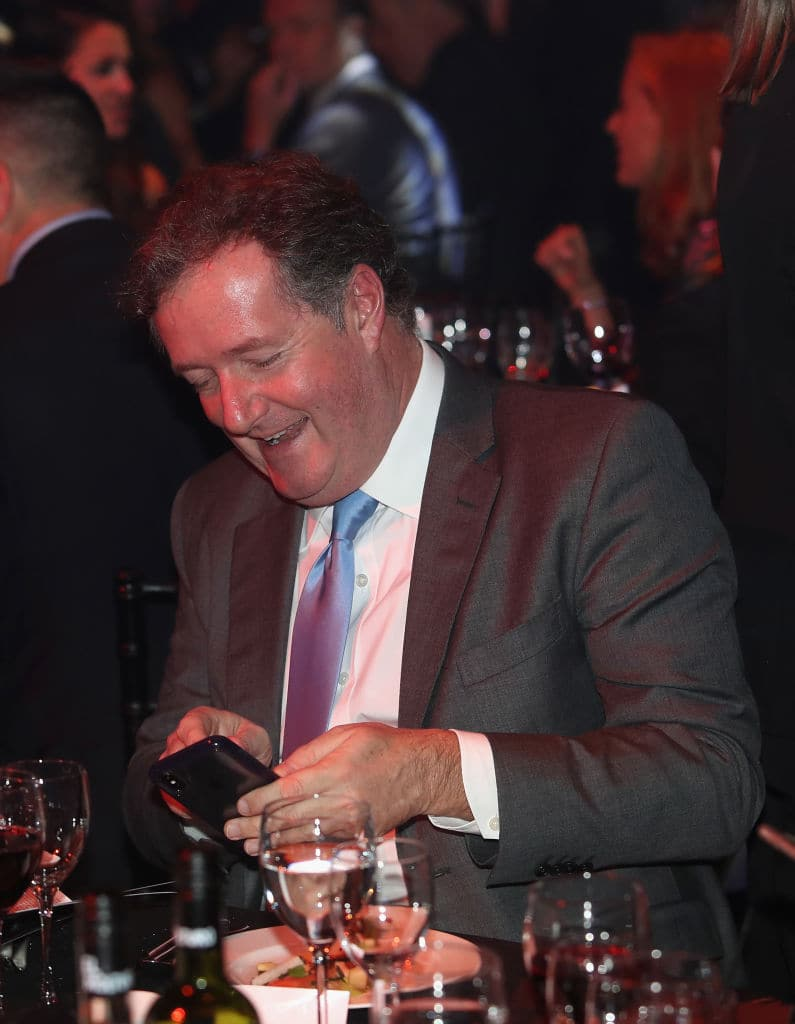 Piers Morgan smiles as he uses his phone as the PCA Host 'An Evening with Freddie Flintoff and Friends' at The Roundhouse on November 29, 2017 in London (Getty Images)