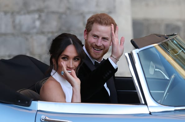 Meghan Markle and Prince Harry, who is wearing the bracelet (Source: Getty Images)