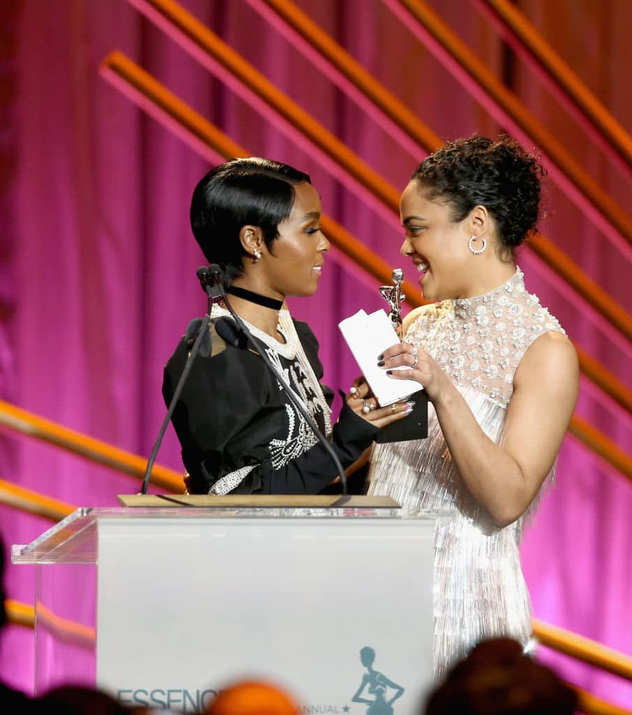 Janelle Monae (L) and Honoree Tessa Thompson speak onstage during the 2018 Essence Black Women In Hollywood Oscars Luncheon at Regent Beverly Wilshire Hotel on March 1, 2018 in Beverly Hills, California. (Photo by Rich Polk/Getty Images for Essence)