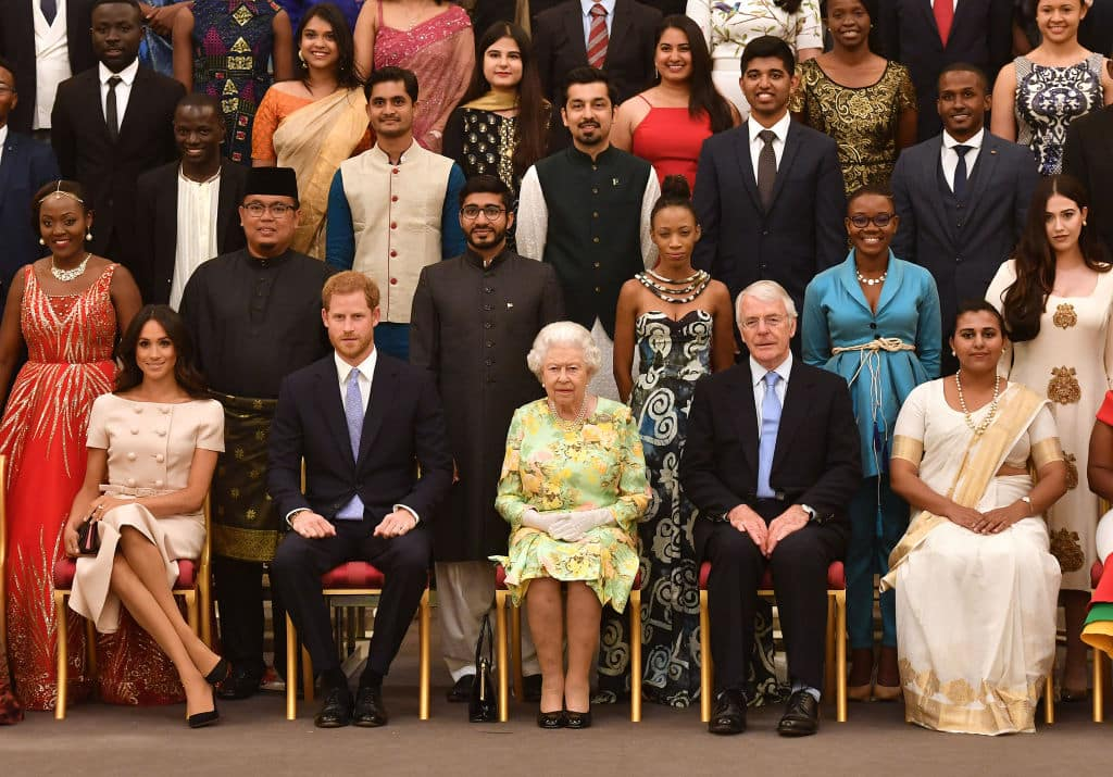 Meghan, Duchess of Sussex, Prince Harry, Duke of Sussex, Queen Elizabeth II and John Major at the Queen's Young Leaders Awards Ceremony at Buckingham Palace on June 26, 2018 in London, England. (Photo by John Stillwell - WPA Pool/Getty Images)
