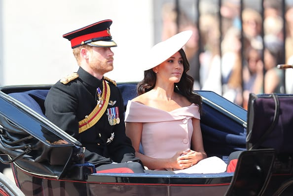 Prince Harry, Duke of Sussex and Meghan, Duchess of Sussex during Trooping The Colour on the Mall on June 9 2018, marking the official birthday of the Sovereign, even though the Queen's actual birthday is on April 21st (Photo by Chris Jackson/Getty Images)