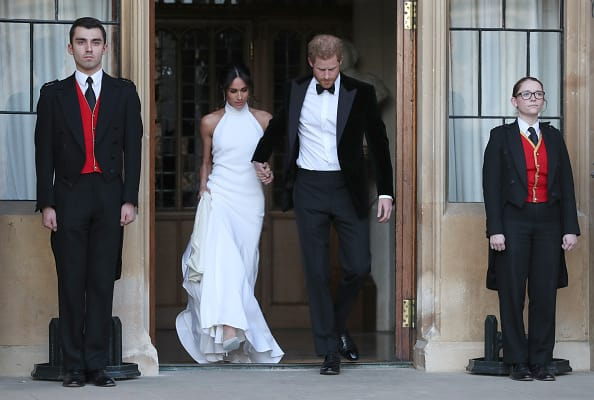 Duchess of Sussex and Prince Harry, Duke of Sussex leave Windsor Castle after their wedding to attend an evening reception at Frogmore House, hosted by the Prince of Wales on May 19, 2018 in Windsor, England (Photo by Steve Parsons - WPA Pool/Getty Images)