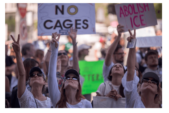 People call out words of encouragement to detainees held inside the Metropolitan Detention Center after marching to decry Trump administration immigration and refugee policies on June 30, 2018 in Los Angeles, California. (Getty Images)